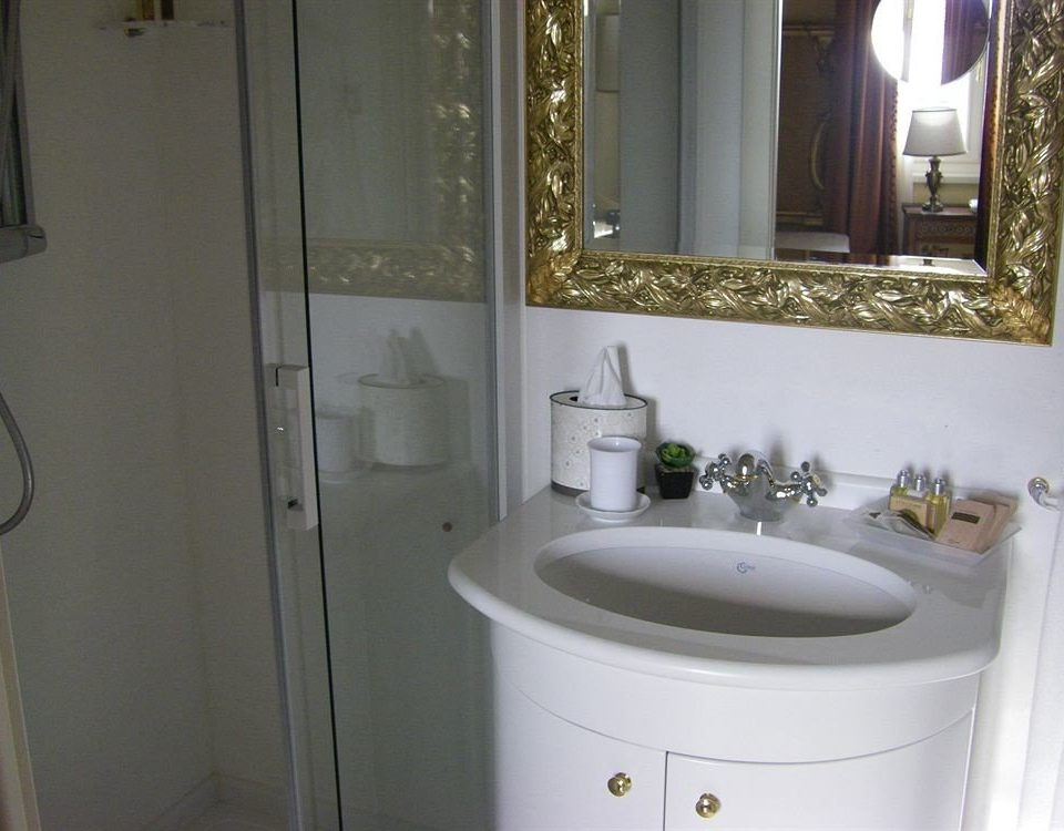 bathroom mirror property sink white home toilet plumbing fixture cottage flooring