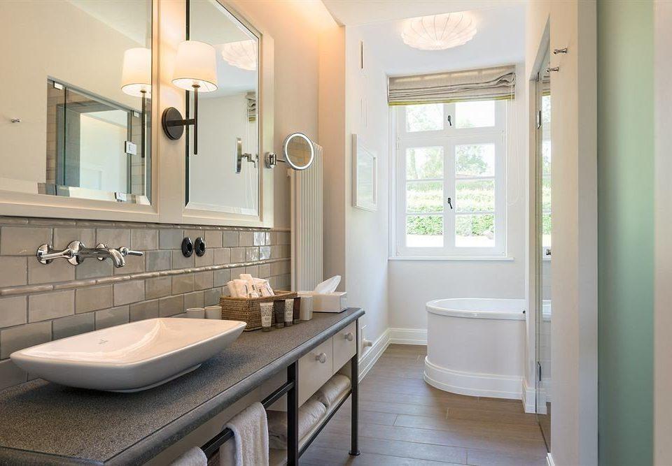bathroom mirror property sink home cottage flooring