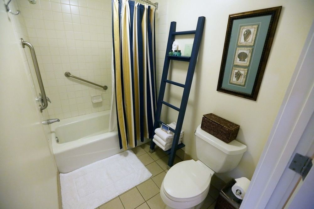 bathroom toilet property house home white sink cottage plumbing fixture flooring rack trash tiled