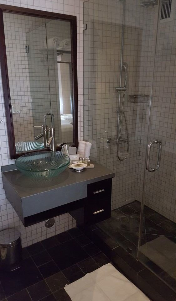 bathroom property sink tile plumbing fixture home flooring tiled cottage toilet