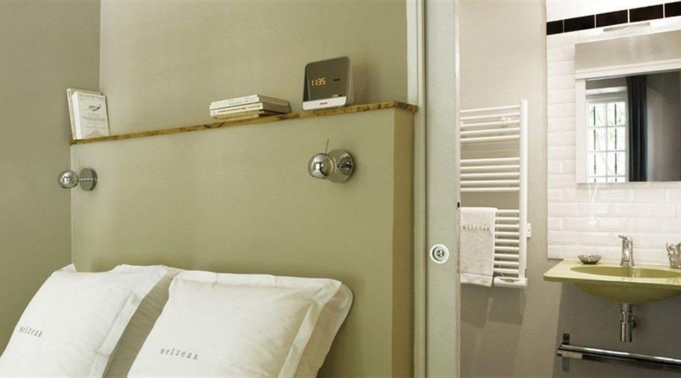 bathroom mirror property green sink plumbing fixture towel cottage tan