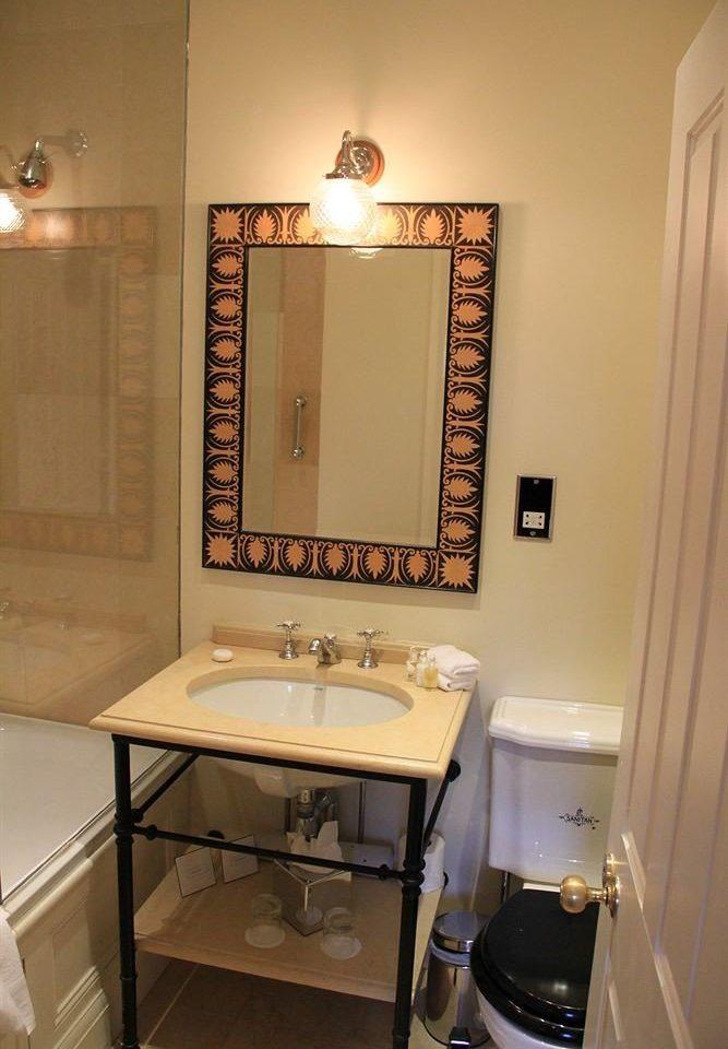bathroom sink mirror property house home toilet lighting cottage plumbing fixture