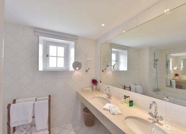 bathroom mirror property sink toilet home cottage tile