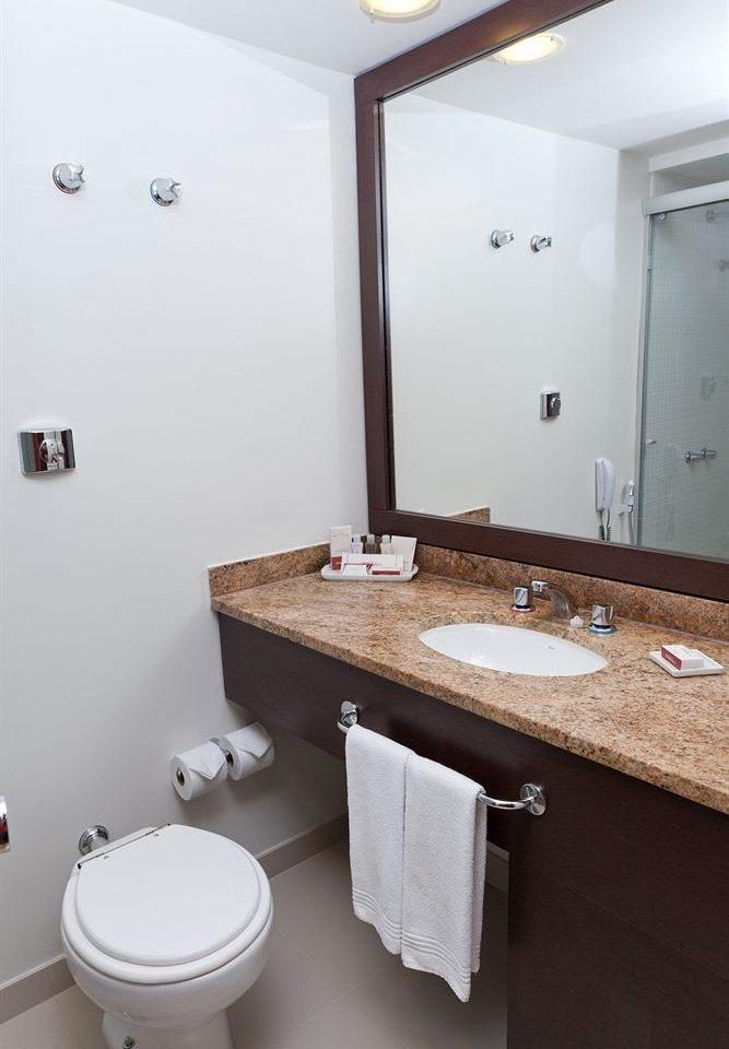 bathroom mirror sink property toilet home cottage plumbing fixture rack tile