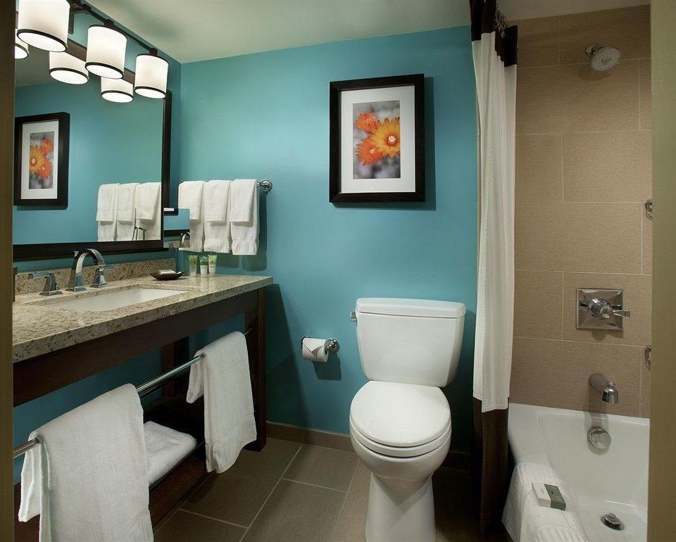 bathroom toilet sink property mirror home cottage plumbing fixture rack tan