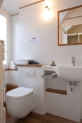 bathroom toilet sink property home plumbing fixture cottage tile