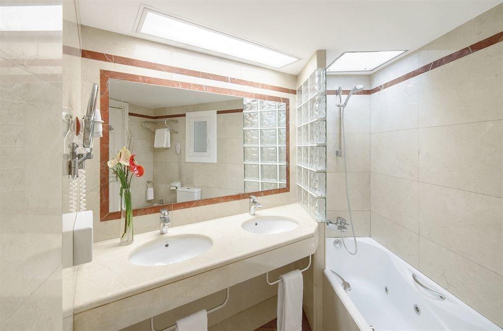 bathroom property sink home cottage toilet tan tiled
