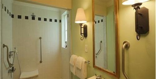 bathroom mirror property sink plumbing fixture towel toilet public toilet cottage rack tan