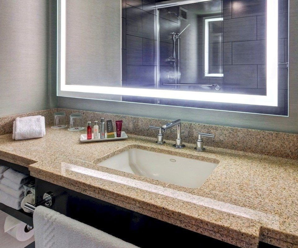 bathroom sink mirror property countertop home flooring counter tile plumbing fixture material tan