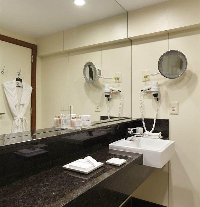 bathroom sink mirror property counter home lighting flooring countertop plumbing fixture long