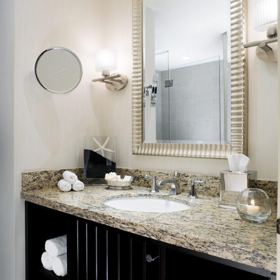 bathroom mirror sink plumbing fixture home counter towel countertop