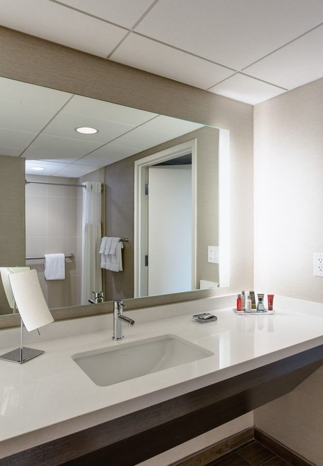 bathroom sink mirror property counter long daylighting flooring