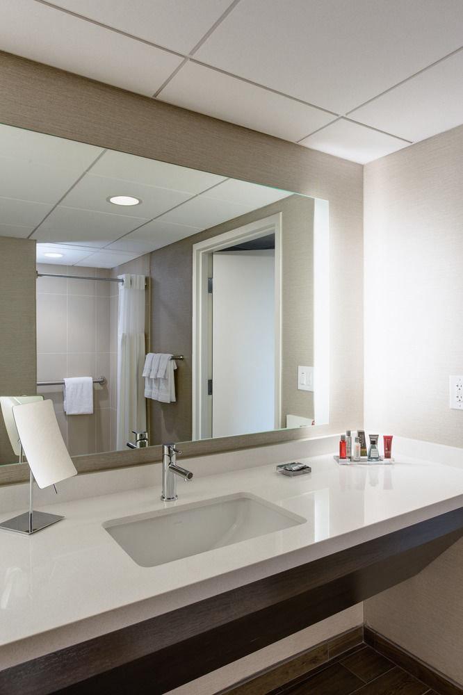 bathroom sink mirror property counter long daylighting flooring