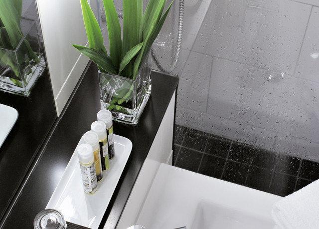 white plant bathroom glass counter plumbing fixture flower