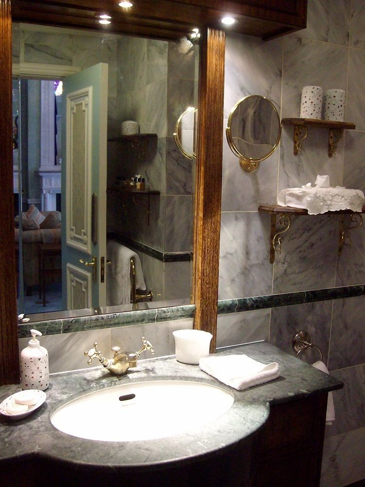 bathroom sink mirror home lighting plumbing fixture counter towel