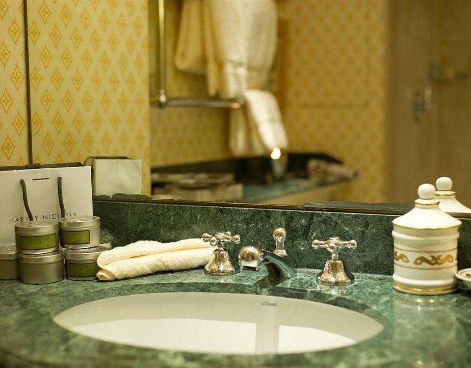 bathroom sink mirror counter towel toilet