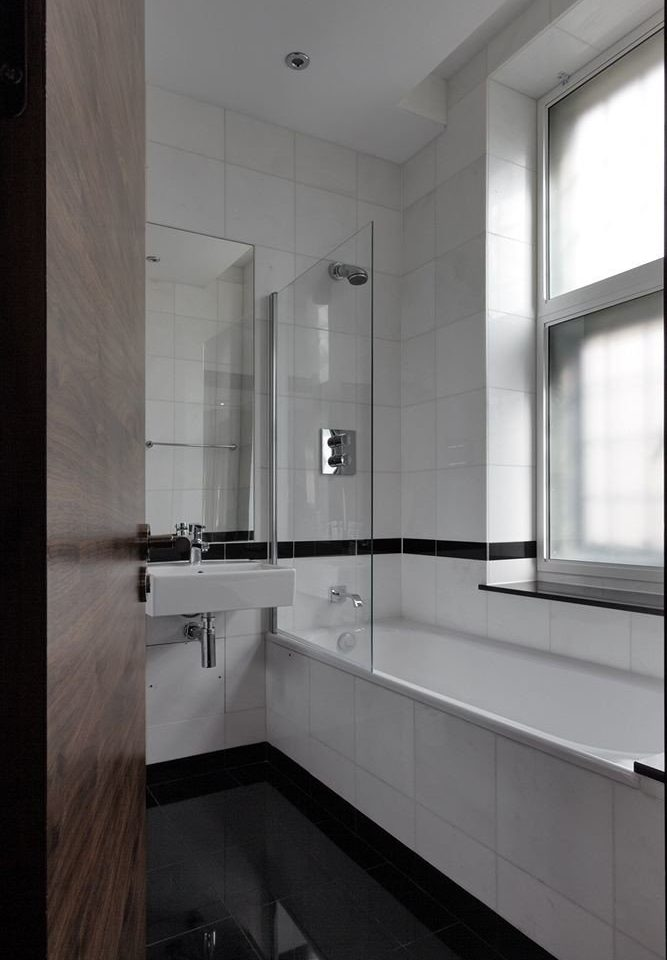 bathroom property white sink lighting home flooring tile daylighting countertop public tiled