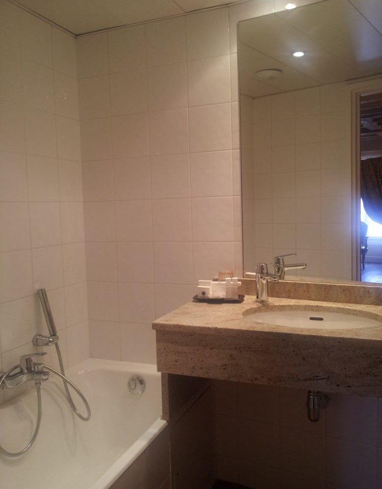 bathroom sink property countertop home lighting toilet flooring plumbing fixture
