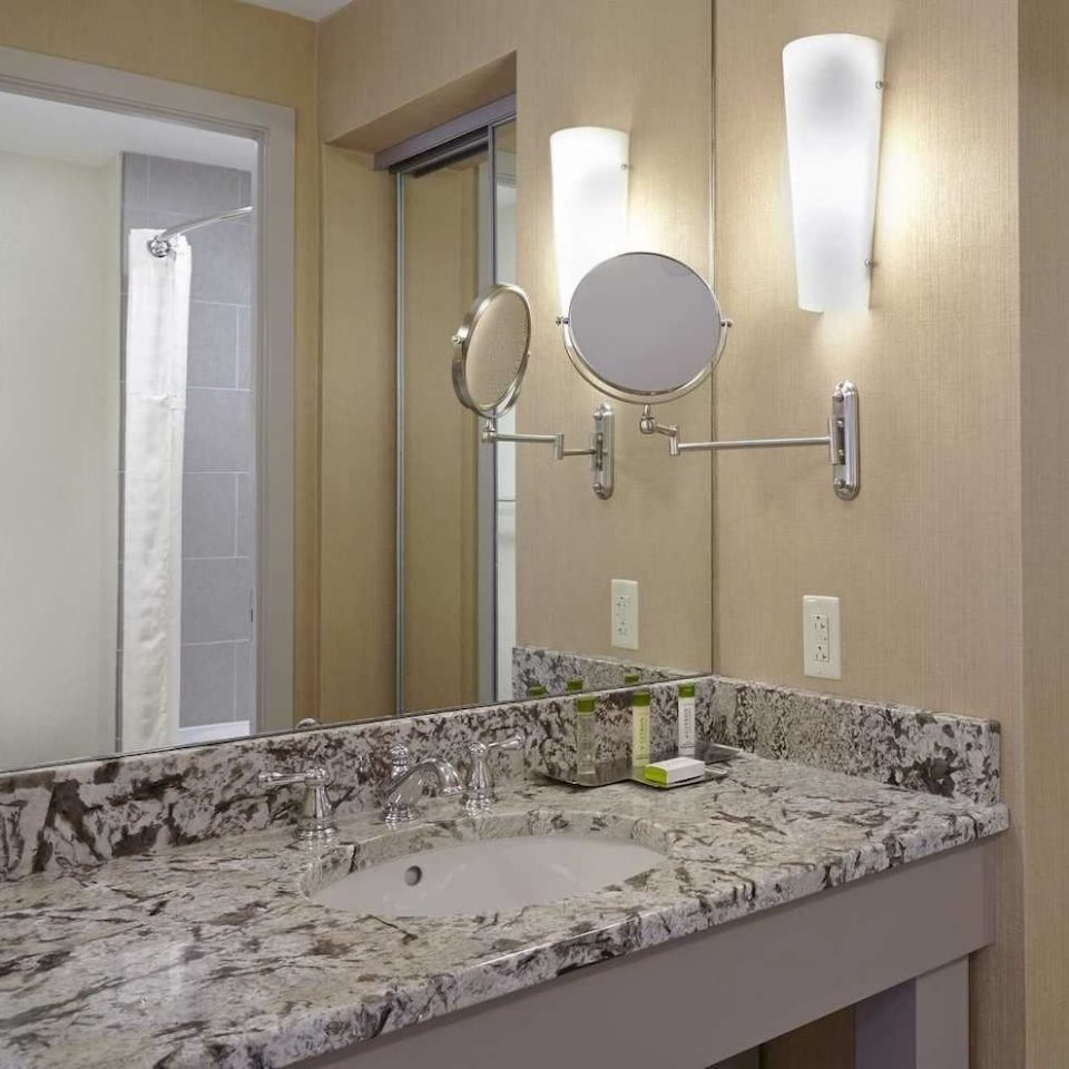 bathroom sink property countertop lighting home flooring material tile tan
