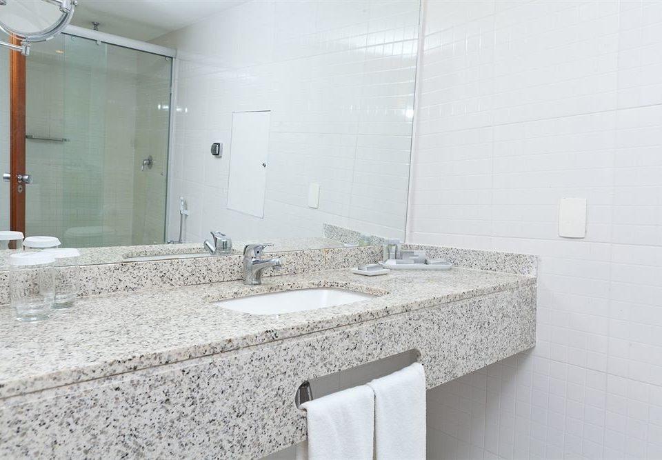 bathroom property tile countertop flooring toilet sink plumbing fixture material