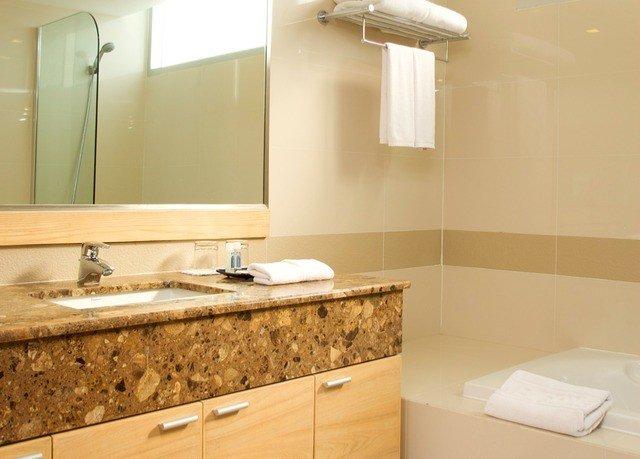 bathroom sink mirror property plumbing fixture countertop