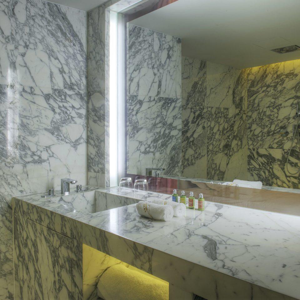 bathroom property sink house plumbing fixture glass flooring curtain tile tiled