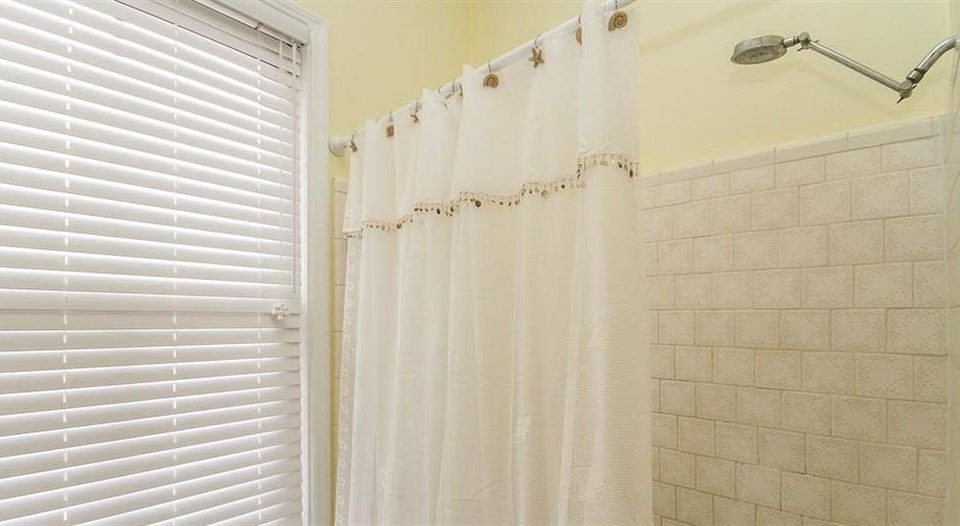 bathroom curtain window treatment textile plumbing fixture white material tile tiled