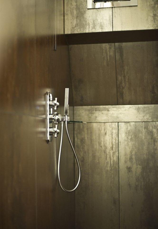 white light darkness plumbing fixture lighting shape line flooring bathroom tiled