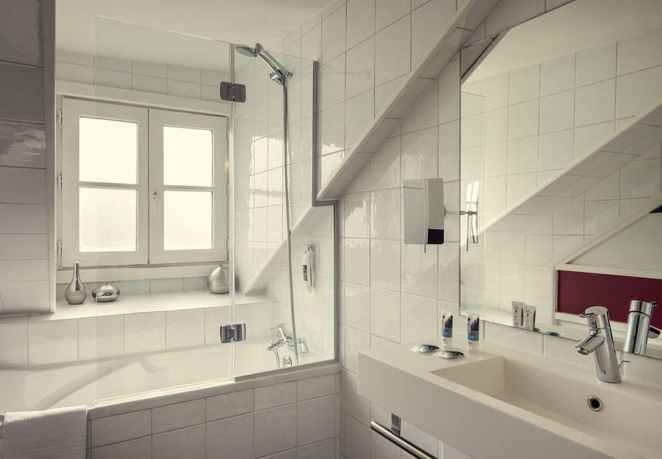 bathroom property house home sink daylighting toilet flooring tile tiled