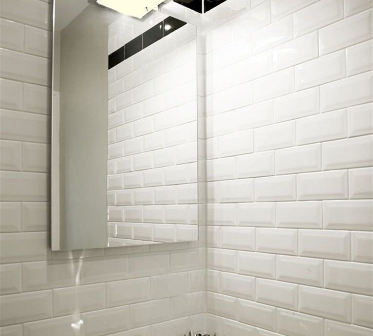 bathroom sink tile flooring lighting plumbing fixture daylighting toilet tiled public