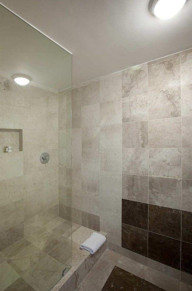 bathroom scene plumbing fixture flooring tile tiled daylighting tan