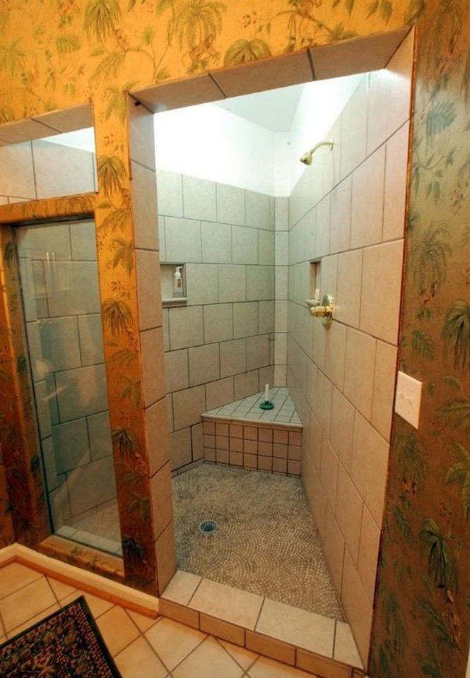 bathroom property house plumbing fixture flooring tile tiled dirty