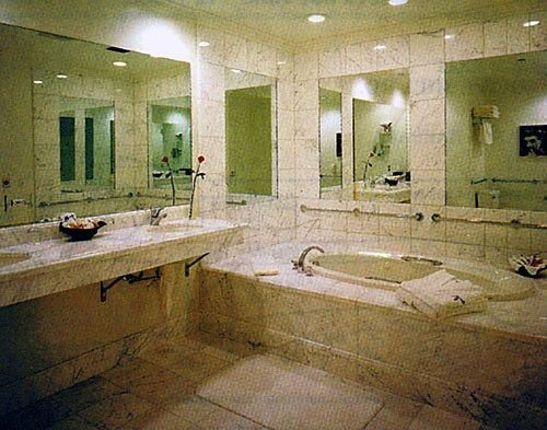 bathroom property swimming pool plumbing fixture flooring mansion sink public dirty