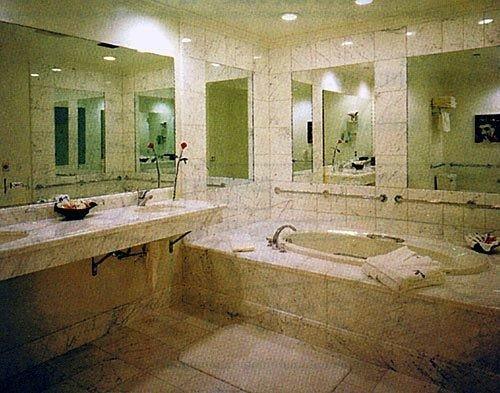 bathroom property swimming pool plumbing fixture flooring mansion sink public dirty