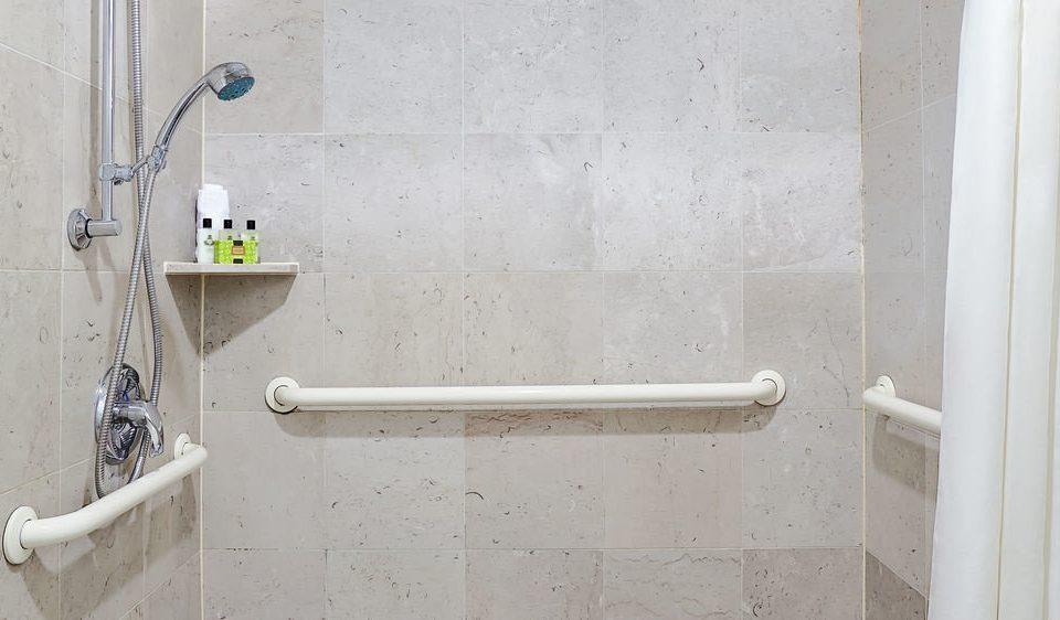 bathroom scene plumbing fixture white tile flooring shower toilet dirty