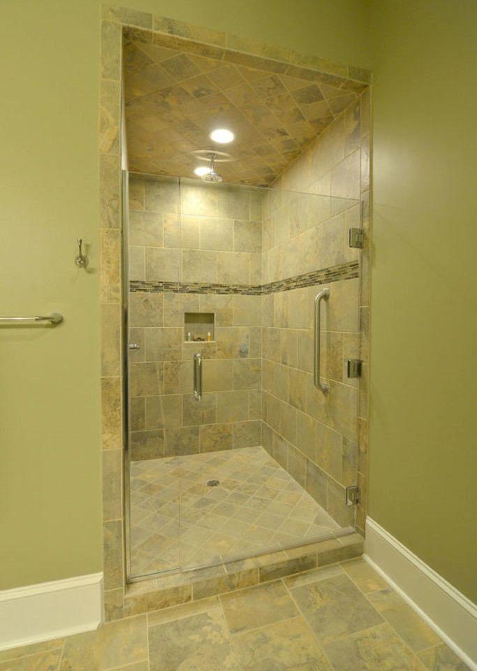 bathroom plumbing fixture shower flooring toilet stall tiled dirty