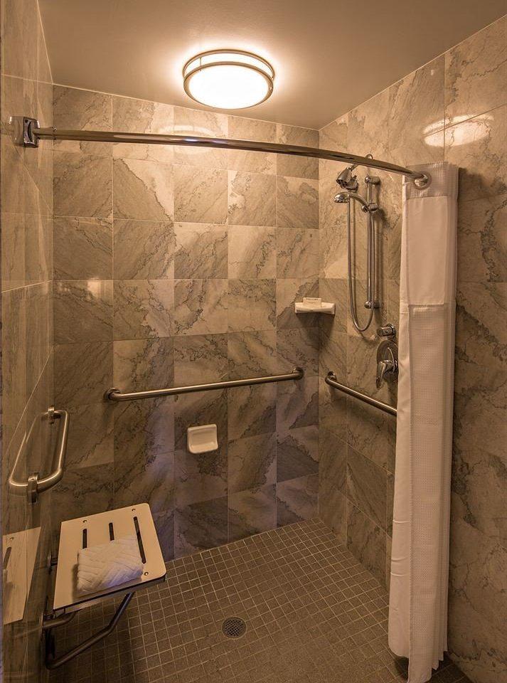 bathroom plumbing fixture public toilet toilet tiled tile dirty