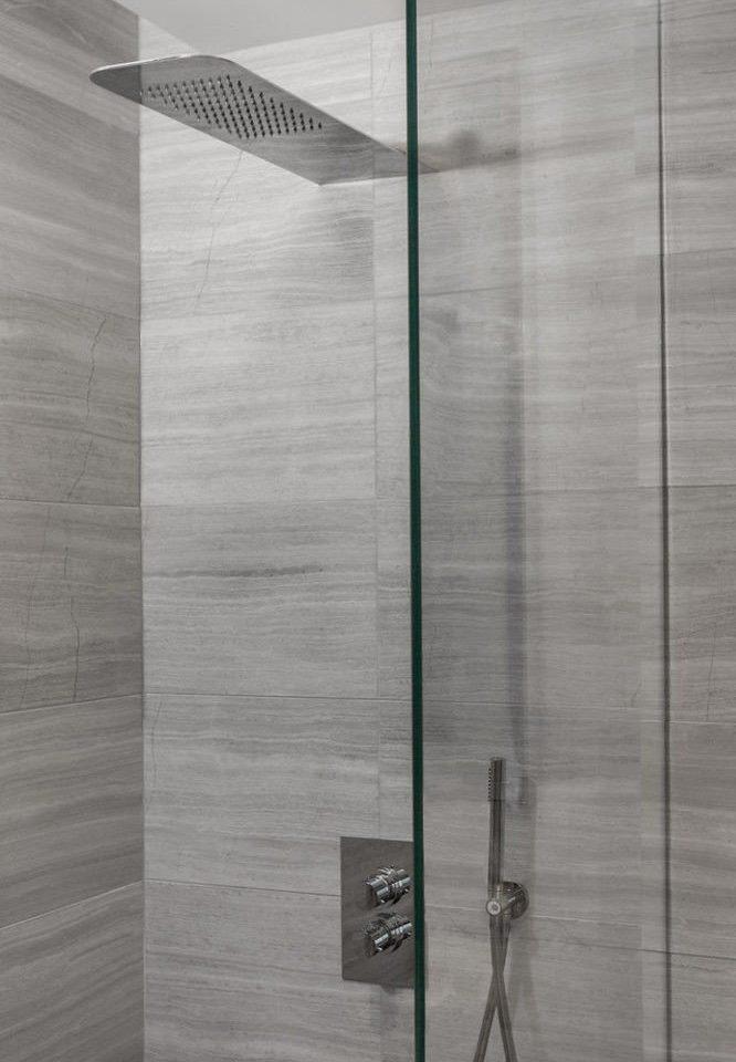 plumbing fixture lighting glass flooring door shower line tile bathroom