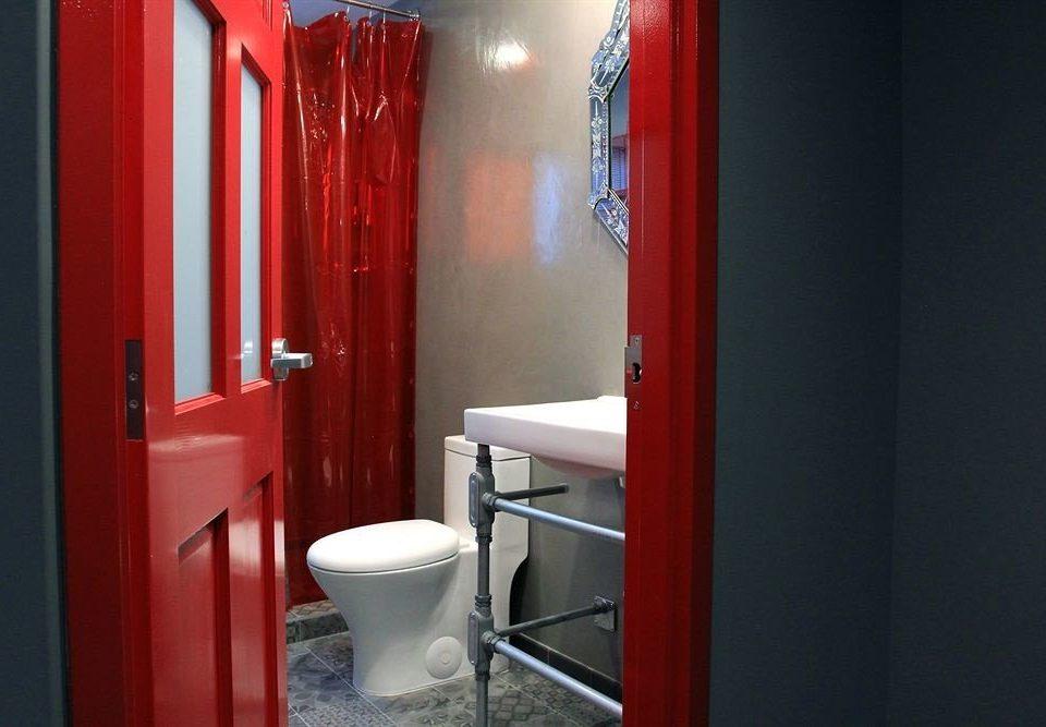 bathroom red toilet plumbing fixture door public toilet public painted