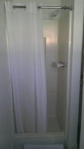 bathroom shower property white plumbing fixture door stall