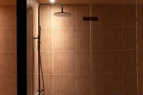 plumbing fixture shower door bathroom toilet tiled tile