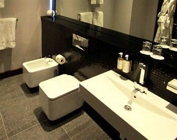 bathroom sink mirror toilet double flooring towel tile