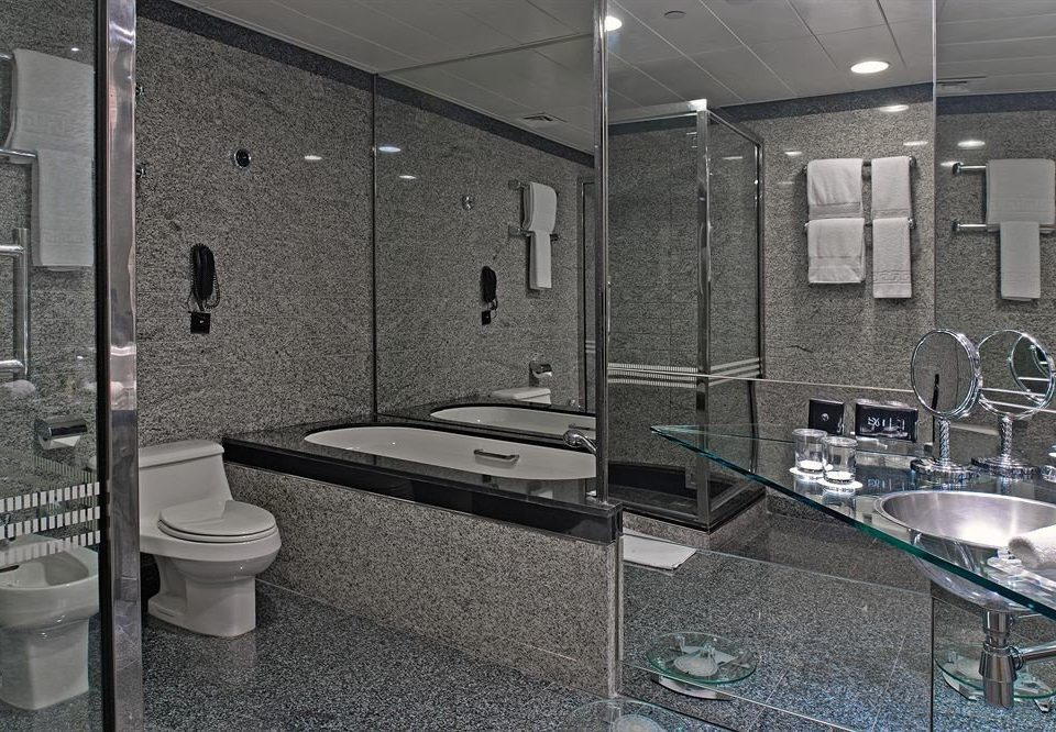 bathroom plumbing fixture public toilet toilet swimming pool glass flooring