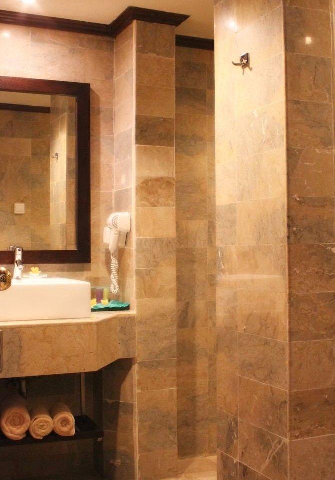 bathroom flooring tile plumbing fixture sink hardwood wood flooring stone tiled