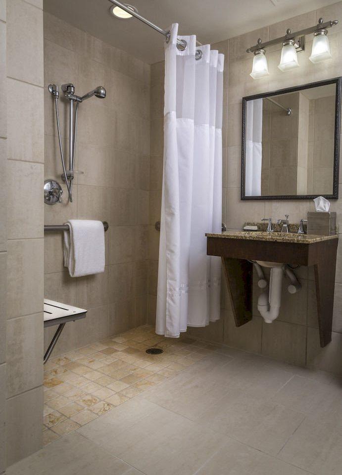 bathroom property sink house plumbing fixture flooring home white toilet tile public toilet tiled