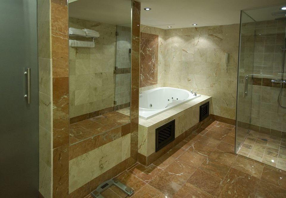 bathroom property house home plumbing fixture flooring sink tile tiled tan