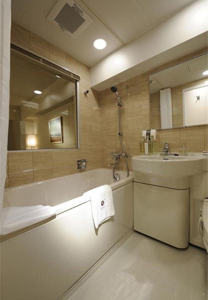 bathroom property house home sink toilet flooring plumbing fixture tan tile