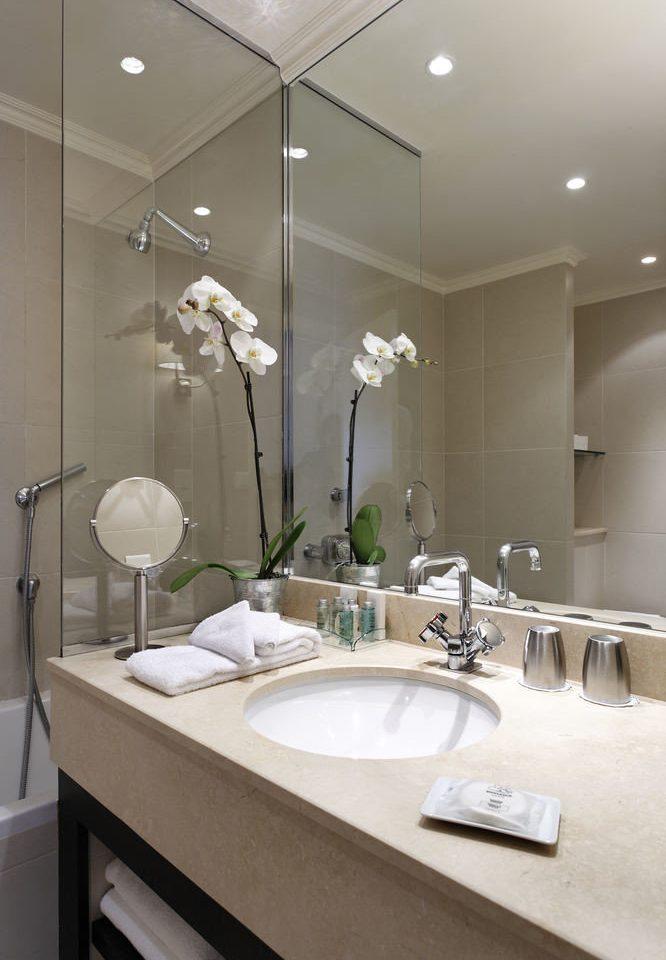 bathroom mirror sink lighting home flooring plumbing fixture toilet