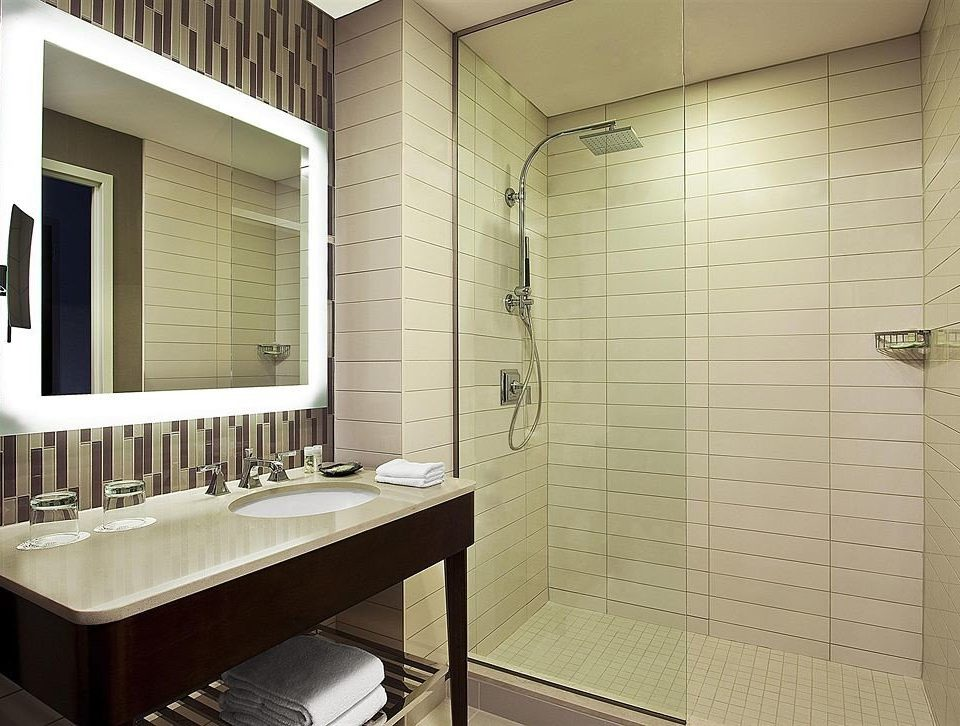 bathroom sink property plumbing fixture home tile flooring long public tiled
