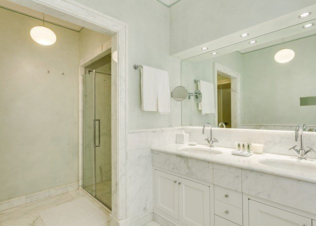 bathroom mirror sink property home flooring tan